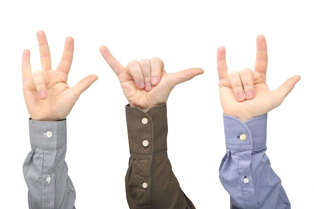 Verschillende gebaren van mannelijke handen tussen elkaar op een witte achtergrond. gebaren relaties in de samenleving. Premium Foto