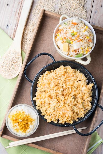 Verschillende rijstgerechten (paella met groenten, tomaat en rijstpudding) Premium Foto