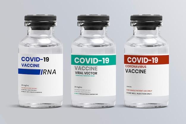 Verschillende soorten covid-19-vaccin in glazen flaconflessen met een label met verschillende opslagtemperatuur Gratis Foto