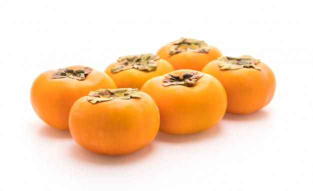 Verse persimmon op witte achtergrond Premium Foto