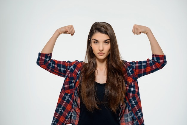 Vertrouwen sterke vrouw flex biceps Gratis Foto