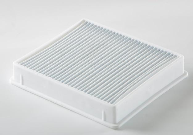 Vervuild stoffilter. stofzuigerfilter op witte achtergrond Premium Foto