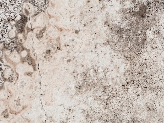 Verweerde getextureerde betonnen muur Gratis Foto