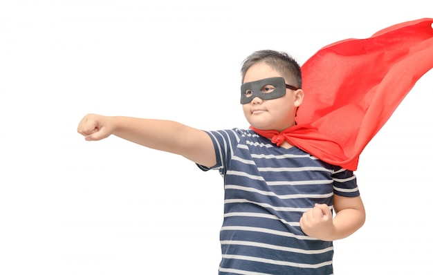 Vet kind speelt geïsoleerde superheld Premium Foto