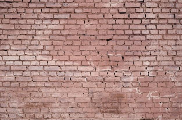 Vierkante de muurachtergrond en textuur van het baksteenblok. geschilderd in rood Premium Foto