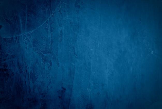 Vintage grunge blauwe concrete textuur studio muur achtergrond met vignet. Gratis Foto