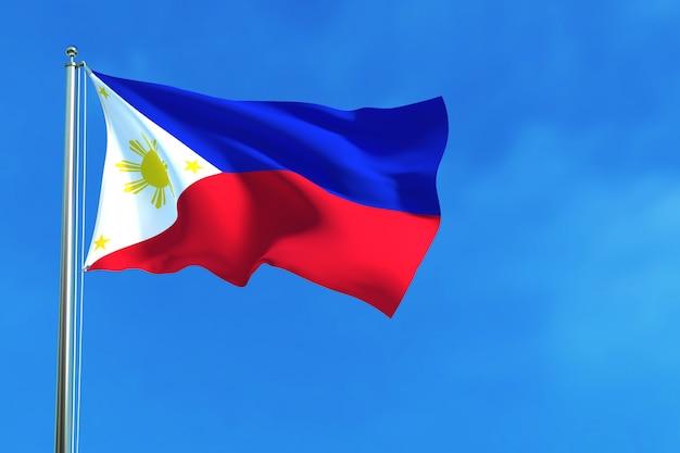 Vlag van filipijnen op de blauwe hemelachtergrond Premium Foto