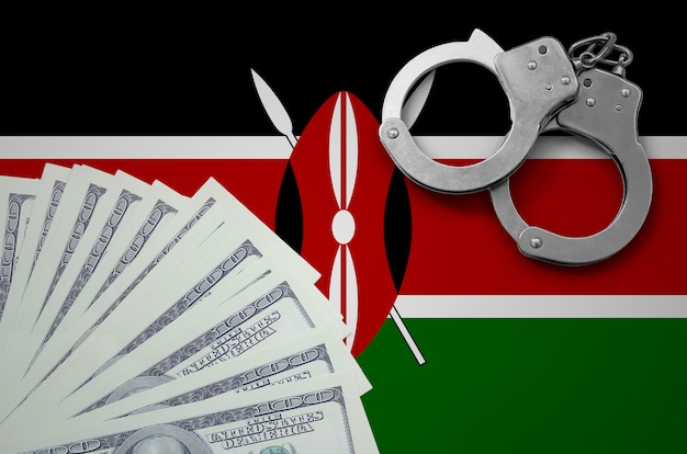 Vlag van kenia met handboeien en een bundel dollars. het concept van illegale bankactiviteiten in amerikaanse valuta Premium Foto