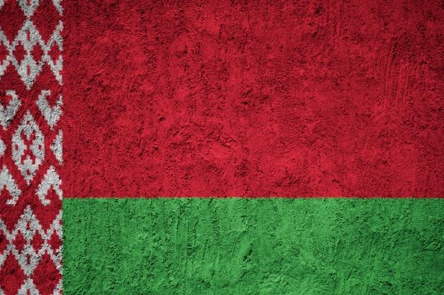 Vlag van wit-rusland op de grunge betonnen muur Premium Foto