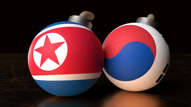 Vlaggen van noord-korea en zuid-korea op bommen Premium Foto