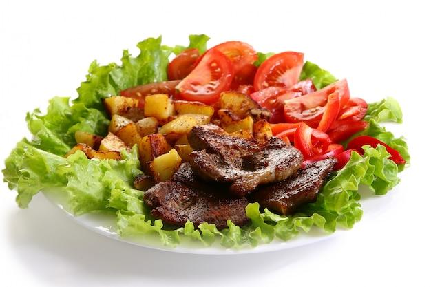 Vleesplaat met aardappels en souce Gratis Foto