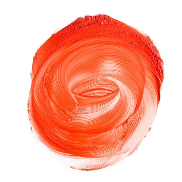 Vlekkerige oranje lippenstifttextuur. fotografie voor cosmetica. Premium Foto