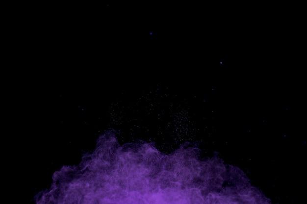 Vliegende gewichtsloze deeltjes paars poeder Premium Foto