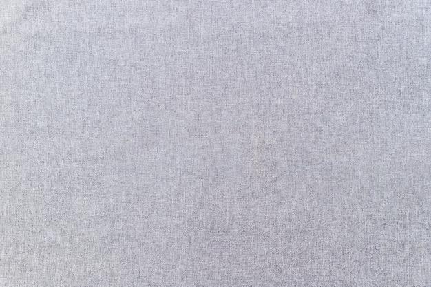 Volledig frame van de grijze achtergrond van de stoffentextuur Gratis Foto