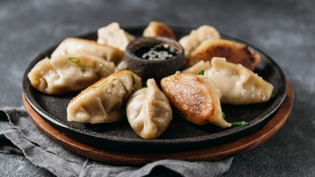 Vooraanzicht japans assortiment dumplings Gratis Foto