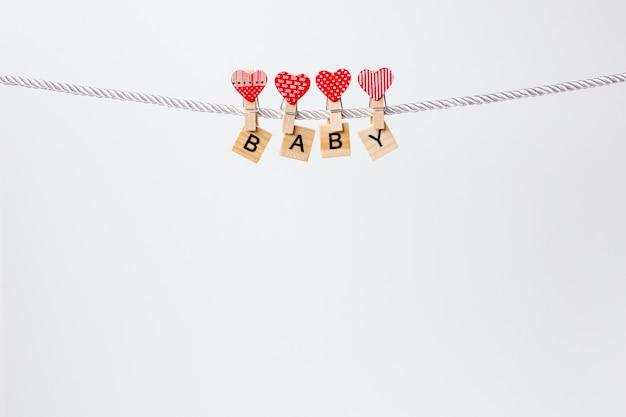 Vooraanzicht van schattige kleine baby-accessoires Gratis Foto