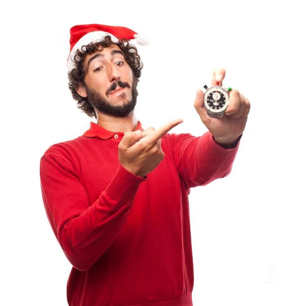 Vrolijke kerel wijst met een chronometer Gratis Foto
