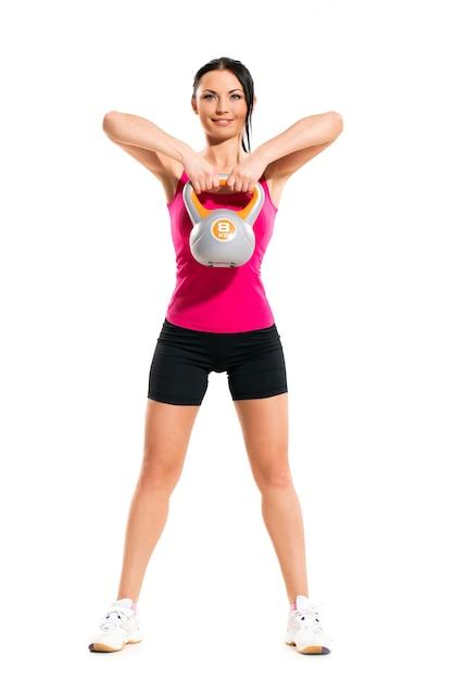 Vrouw tijdens fitness oefeningen Gratis Foto