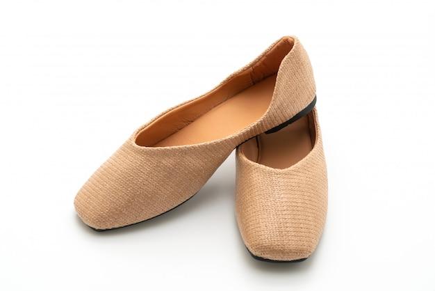 Vrouwelijke en vrouwelijke platte schoenen Premium Foto