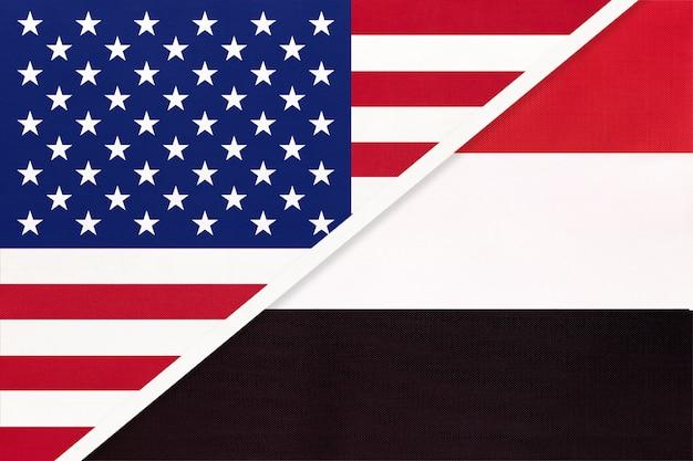 Vs versus jemen nationale vlag van textiel. relatie tussen twee amerikaanse en aziatische landen. Premium Foto