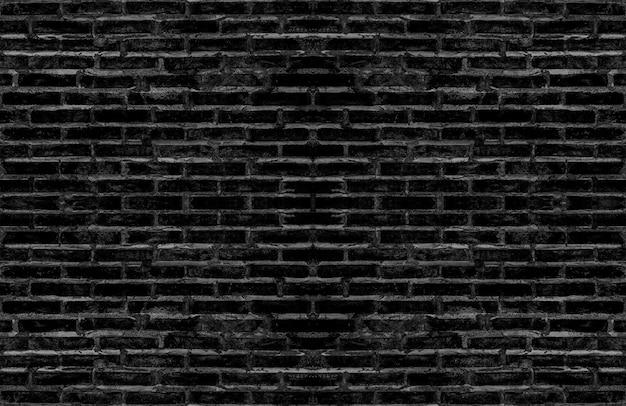 Vuile oude zwarte baksteen geweven muur voor donker toon uitstekend binnenlands ontwerp. Premium Foto