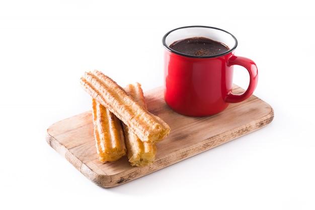 Warme chocolademelk met churros geïsoleerd op wit Premium Foto