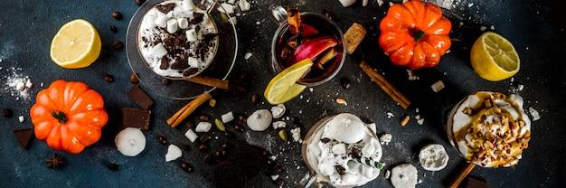 Warme dranken in de herfst, warme chocolademelk, pompoen latte, karamel en pindakoffie latte, glühwein Premium Foto