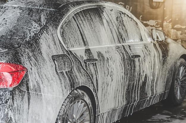 Wasborreltjes voor auto's Premium Foto