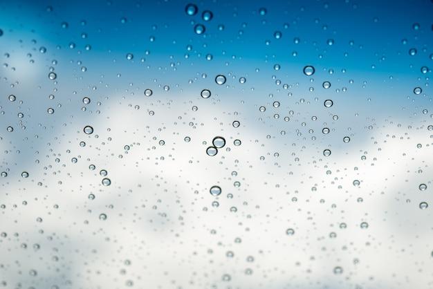 Waterdruppels op glas Gratis Foto