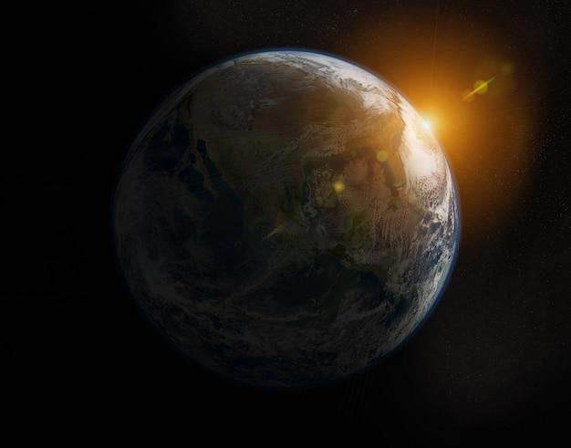 Weergave van blauwe planeet aarde op amerika tijdens een zonsopgang Premium Foto