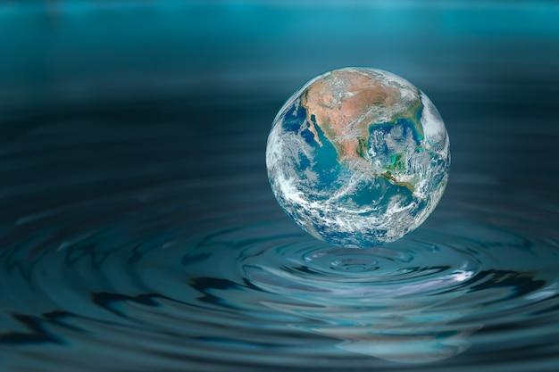 Wereld droppen in een waterdruppel, concept voor watertrekking en conservatief. Premium Foto
