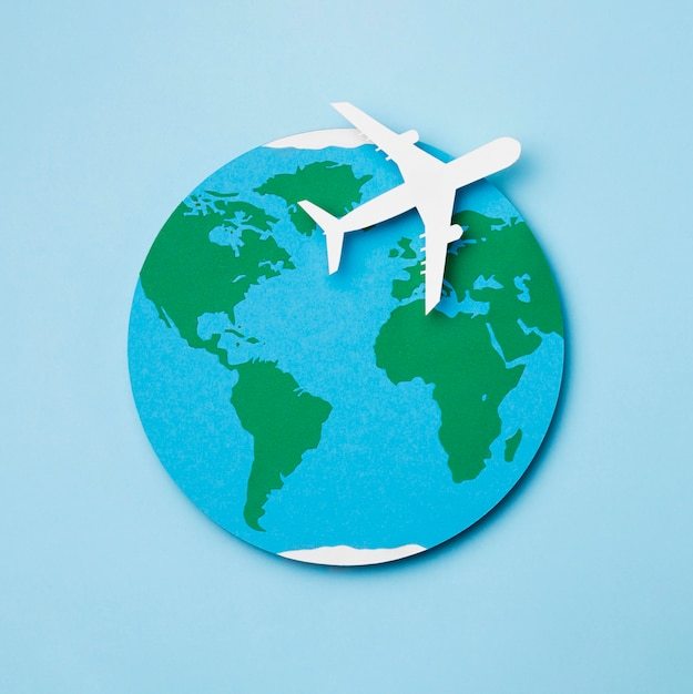 Wereld toerisme dag concept met vliegtuig Premium Foto