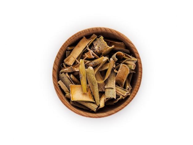Wilgenschors in houten kop op wit Premium Foto