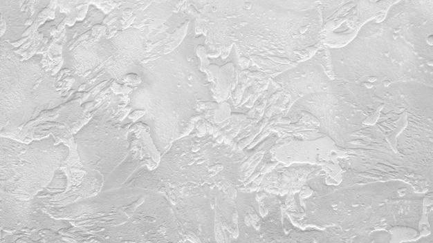 Wit grijs getextureerde muur achtergrond, decoratieve polymeercoating voor binnen en buiten bouwwerkzaamheden Premium Foto