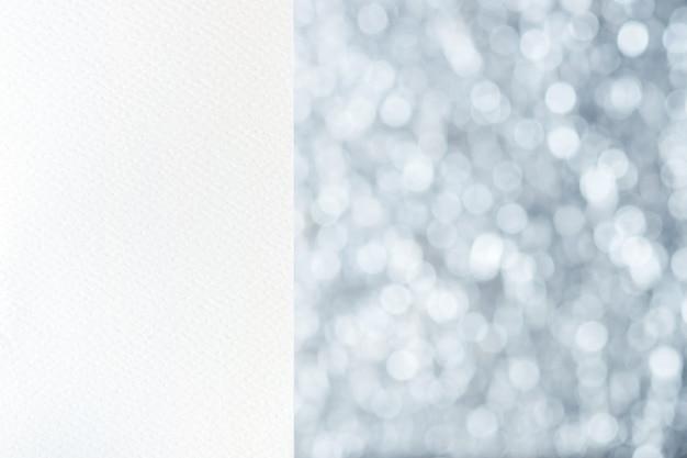 Wit leeg waterverfdocument bij zilveren onduidelijk beeld bokeh lichte achtergrond Premium Foto