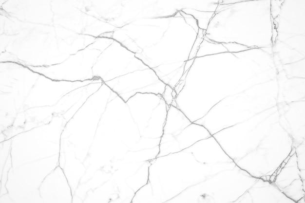 Wit marmer met grijze textuurachtergrond Gratis Foto