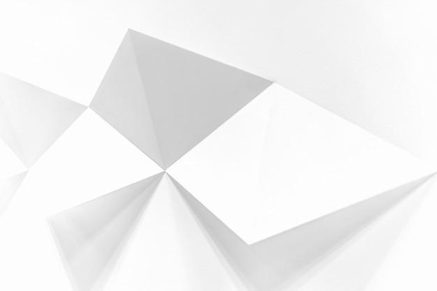 Witte achtergrond met vierkanten die uit de muur komen en een 3d-effect creëren Gratis Foto