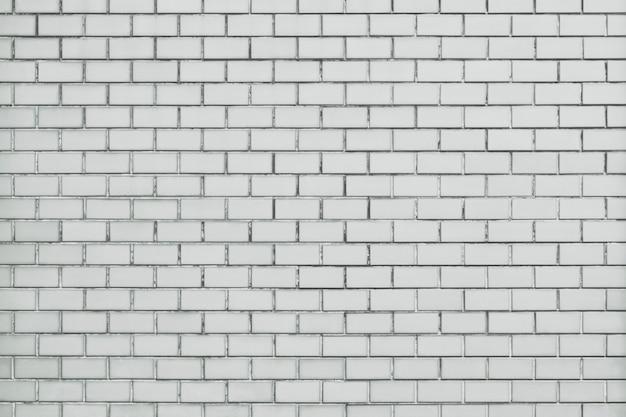 Witte bakstenen muur geweven achtergrond Gratis Foto