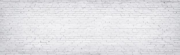 Witte bakstenen muur, textuur van gewit metselwerk als achtergrond Premium Foto