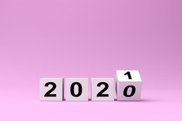 Witte blokjes met de inscriptie 2020 worden vervangen door 2021 op een roze achtergrond, 3d render Premium Foto