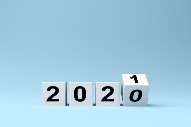Witte blokjes met de inscriptie 2020 wordt vervangen door 2021 op een blauwe achtergrond, 3d render Premium Foto