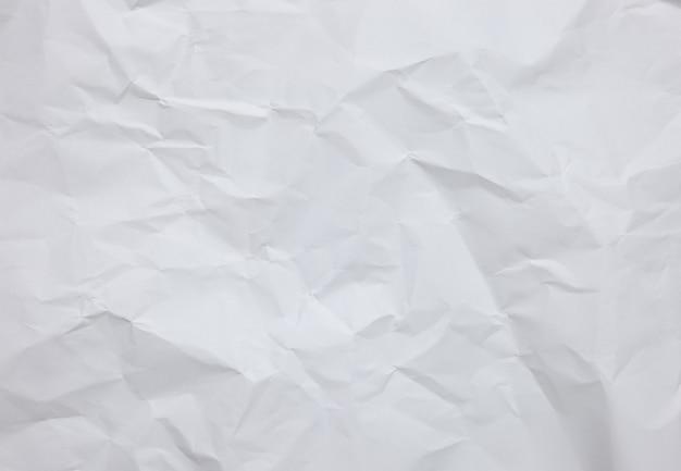 Witte crinkle papier bladachtergrond met texturen Premium Foto