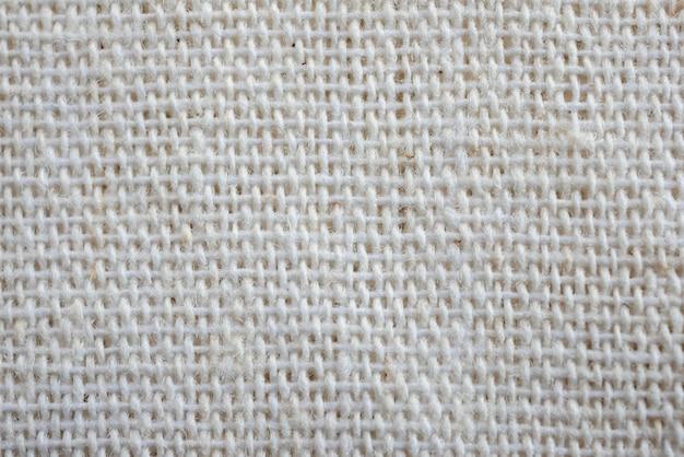 Witte de doek van de calicostof textuur als achtergrond Premium Foto