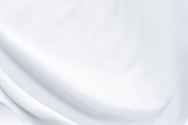 Witte doeksamenvatting als achtergrond met zachte golven. Premium Foto