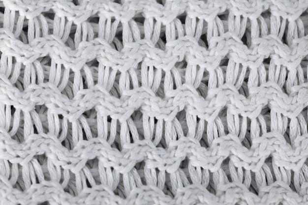 Witte gebreide wollen achtergrond. gebreide warme kleding voor de textuur van de winterstof Premium Foto