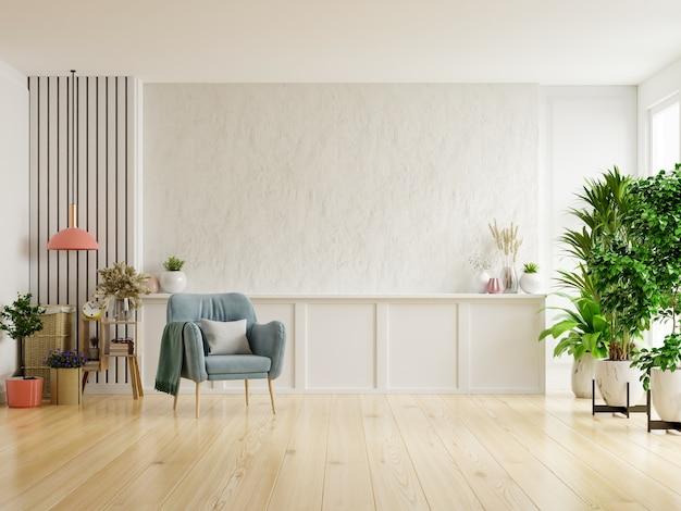 Witte gips muur woonkamer hebben fauteuil en decoratie. Premium Foto