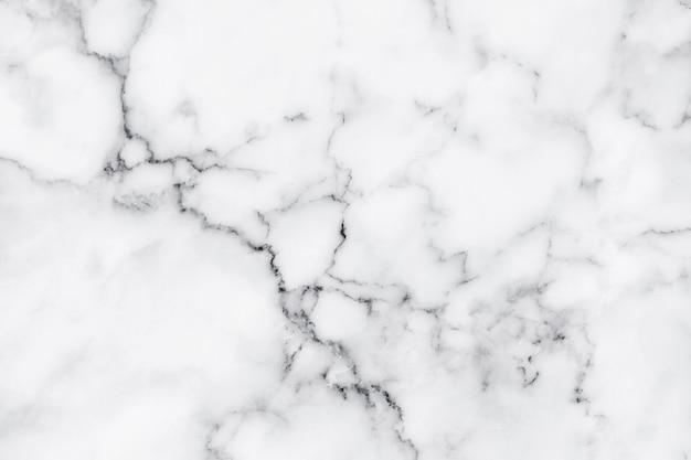 Witte marmeren het patroonsamenvatting van de achtergrondtextuur natuursteen voor het werk van de ontwerpkunst. Premium Foto