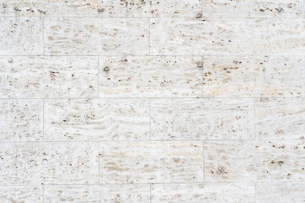 Witte muur onder de lichten - een geweldige foto voor achtergronden en wallpapers Gratis Foto