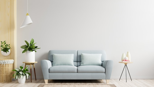 Witte muur woonkamer heeft bank en decoratie, 3d-rendering Gratis Foto