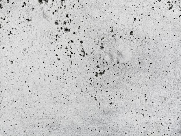 Witte muurtextuur met gaten Gratis Foto